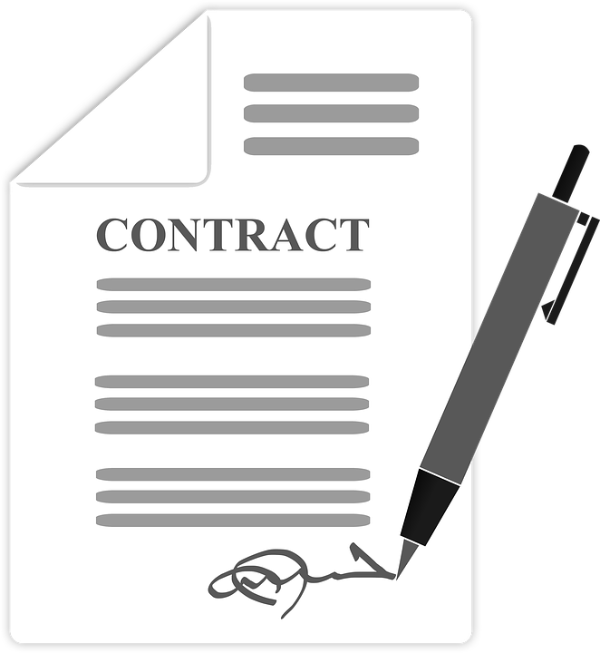 Photo of a contract being signed