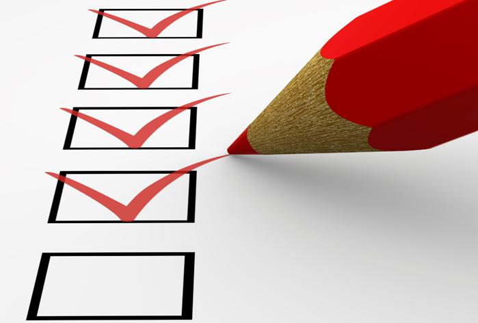 Image of red pencil ticking the Pre-Qualification Questionnaire boxes